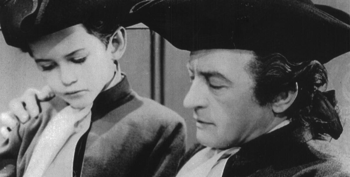 L'attore Claude Rains nei panni di Haym Salomon nel film della Warner Bros.